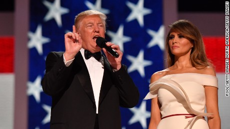 WASHINGTON, DC - JANUARY 20: President Donald Trump and First Lady Melania Trump speak to supporters at the Liberty Ball at the Washington Convention Center on January 20, 2017 in Washington, D.C. Trump will attend a series of balls to cap his Inauguration day.   (Photo by Kevin Dietsch - Pool/Getty Images)