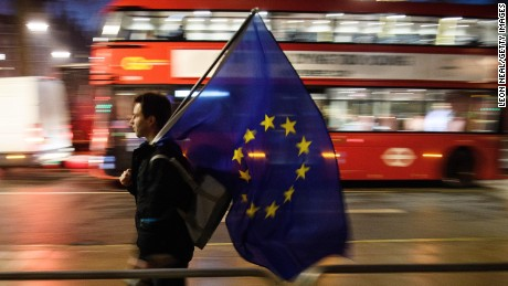 A man carries a European Union flag outside the Supreme Court in London.