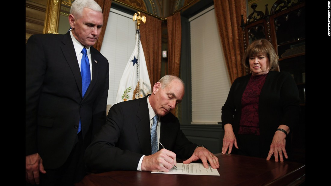 Retired Marine Gen. John Kelly signs his confirmation letter on January 20. He is joined by his wife, Karen.
