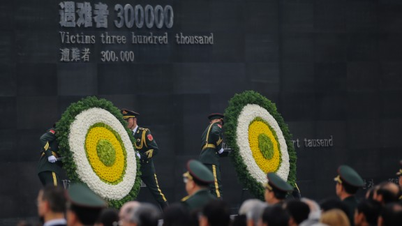 Guards place wreaths at a ceremony to mark the anniversary of the Nanjing Massacre in China.