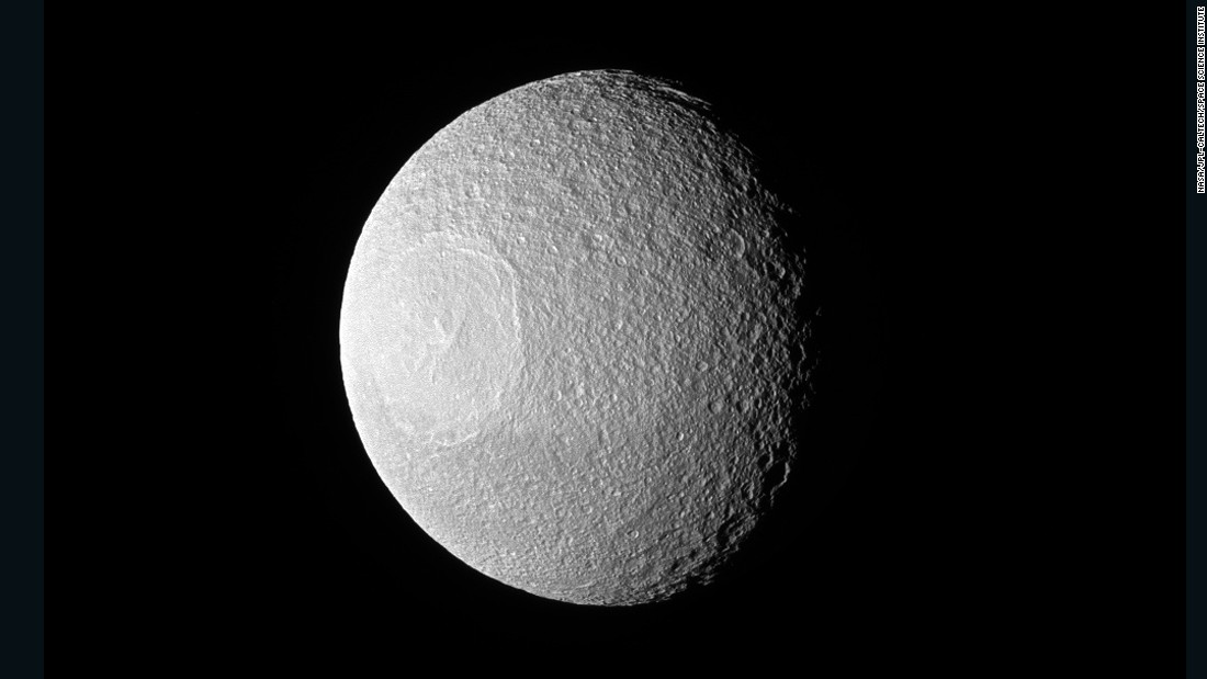 "This photo of Saturn's large icy moon, Tethys, was taken by NASA's Cassini spacecraft, which sent back some<a href=""http://www.cnn.com/2014/06/27/tech/gallery/cassinis-top-discoveries/"" target=""_blank""> jaw-dropping images</a> from the ringed planet."