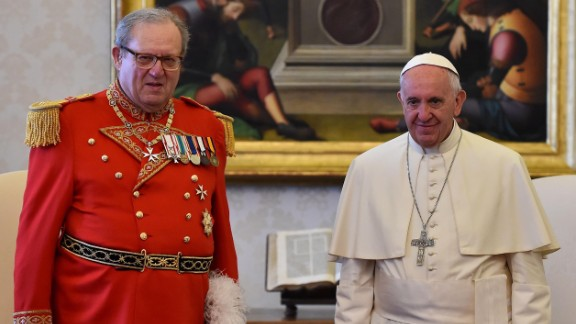 Pope Francis (R) stands with Robert Matthew Festing, Prince and Grand Master of the Sovereign Order of Malta during a private audience on June 23, 2016 at the Vatican. / AFP / POOL / GABRIEL BOUYS (Photo credit should read GABRIEL BOUYS/AFP/Getty Images)
