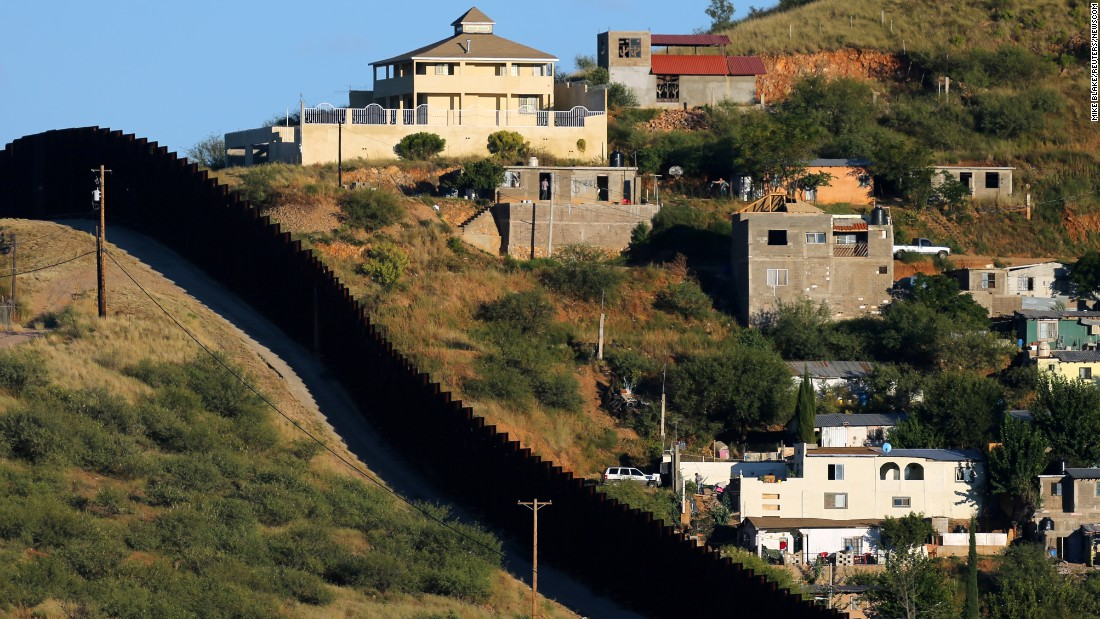 the border fence separates two sides of nogales nogales mexico on the right