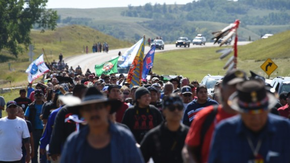Protestors march to a construction site for the Dakota Access Pipeline to express their opposition to the pipeline, at an encampment where hundreds of people have gathered to join the Standing Rock Sioux Tribe