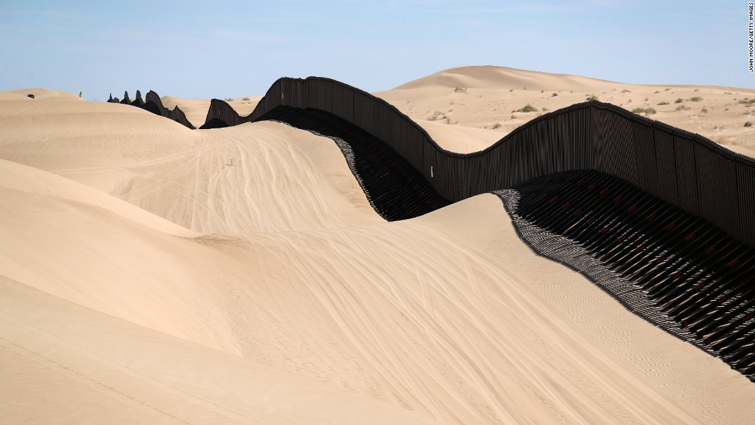 in california part of the us mexico border fence snakes over sand dunes that