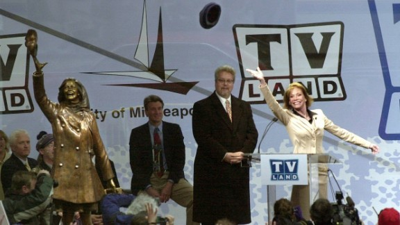 """Moore re-enacts her famous hat toss afer a bronze statue of her was unveiled in 2002. The statue was unveiled in Minneapolis, where """"The Mary Tyler Moore Show"""" takes place."""