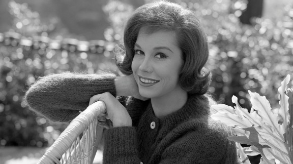 Moore poses for a portrait in 1964. She began her career as a dancer.