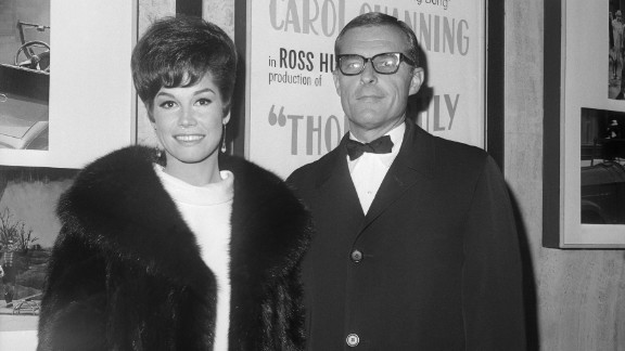 """Moore and her second husband, Grant Tinker, attend the premiere of """"Thoroughly Modern Millie."""" The two started the television production company MTM Enterprises, which produced """"The Mary Tyler Moore Show"""" as well as such acclaimed series as """"The Bob Newhart Show,"""" """"Hill Street Blues"""" and """"St. Elsewhere."""""""