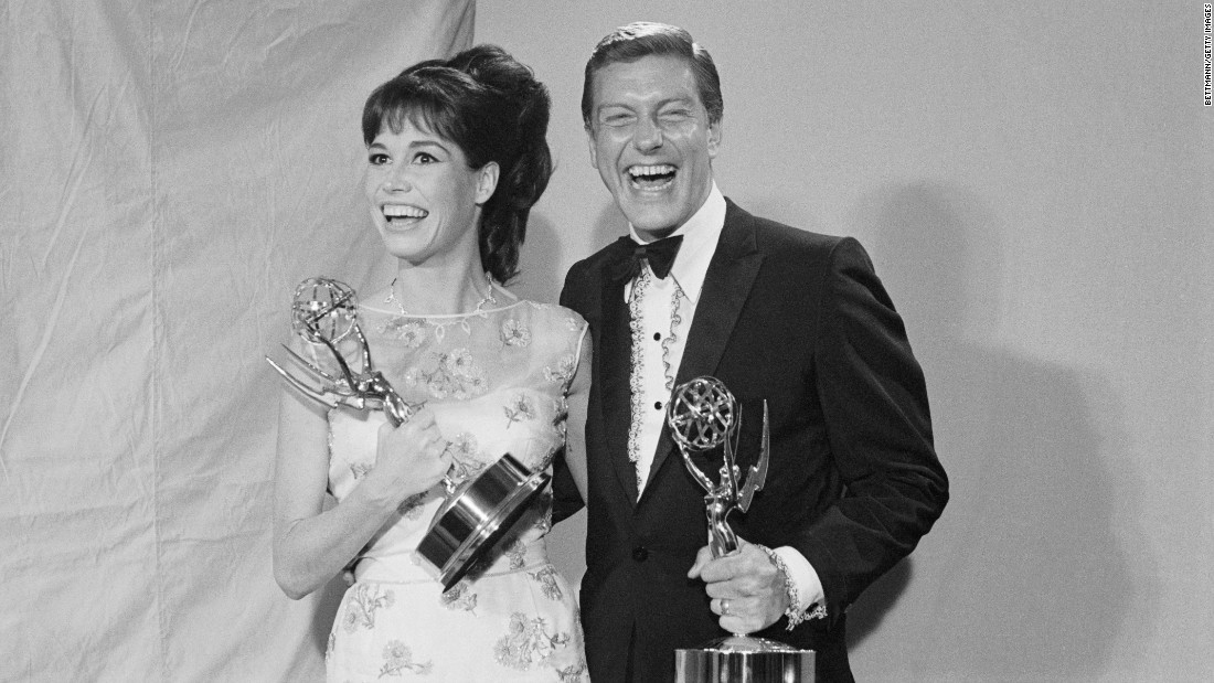 "Moore and Van Dyke hold Emmy Awards in 1966. Moore won two Emmys for ""The Dick Van Dyke Show"" and four for ""The Mary Tyler Moore Show."""