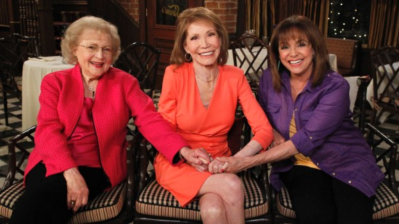 """From left, Betty White, Moore and Valerie Harper sit together at a 2013 reunion of cast members from """"The Mary Tyler Moore Show."""""""