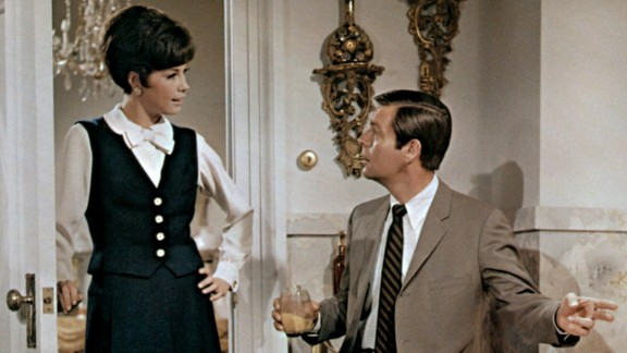 """Moore, Robert Wagner and Barbara Rhoades, right, appear in the 1968 film """"Don't Just Stand There!"""""""