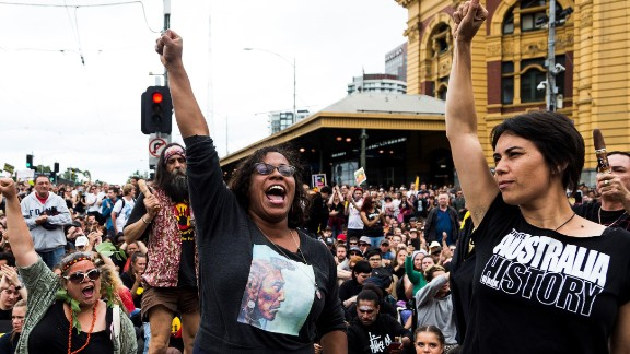 """MELBOURNE, AUSTRALIA - JANUARY 26 : Australian Actress Shareena Clanton (2nd R) raises her hand, during a protest organized by Aboriginal rights activists on Australia Day in Melbourne, Australia on January 26, 2017. """"Australia Day"""" is named by some as """"Invasion Day"""" due to the dispossession of Indigenous land and the arrival of the First Fleet's at Port Jackson, Sydney, Australia in 1788. (Photo by Asanka Brendon Ratnayake/Anadolu Agency/Getty Images)"""