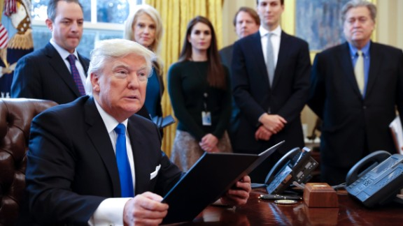 Looking on as President Trump signs an executive order in January are White House Chief of Staff Reince Priebus, counselor to the President Kellyanne Conway, White House Communications Director Hope Hicks, Senior Advisor Jared Kushner and Senior Counselor Stephen Bannon.
