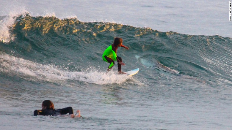 Boy comes close to shark while surfing