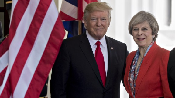 U.S. President Donald Trump, left, stands with Theresa May, U.K. prime minister, while arriving to the West Wing of the White House in Washington, D.C., U.S., on Friday, Jan. 27, 2017. The British prime minister is planning to pitch a free-trade deal to the new U.S. leader just as the reality of a new era of protection for American workers sinks in. Photographer: Andrew Harrer/Bloomberg via Getty Images