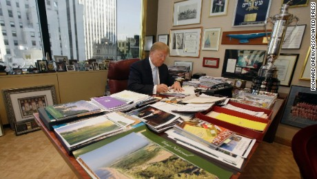 Donald Trump works at his desk in his New York office, Monday, Nov. 22, 2010. (AP Photo/Richard Drew)