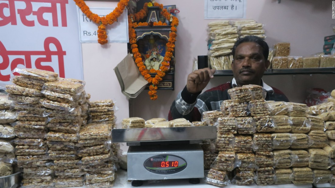 <strong>Peanut brittle:</strong> A market vendor in Rishikesh Town sells fresh peanut brittle. India accounts for 16% of the world's peanut production, according to the Food and Agriculture Organization of the United Nations.