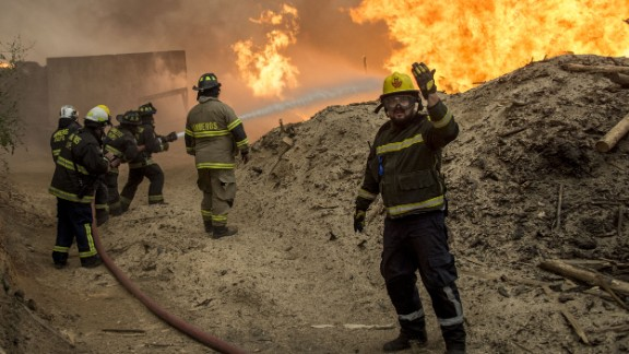 At least 10 people have died, many of them firefighters.