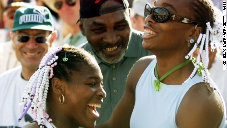Serena celebrates her Evert Cup final victory over Steffi Graf in 1999 with her sister Venus and her father Richard.