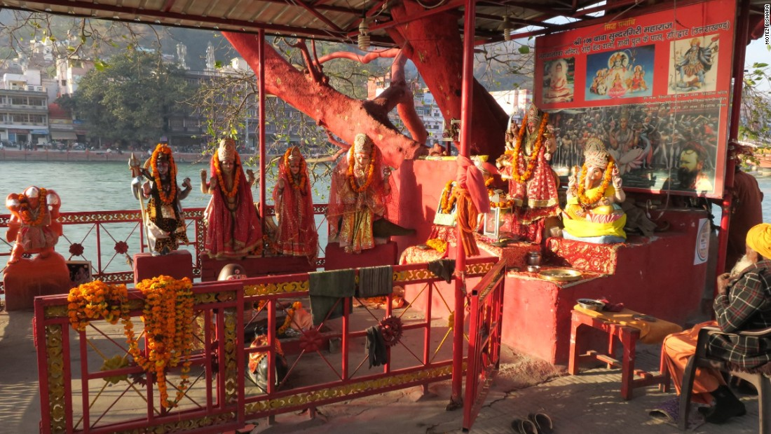 <strong>Haridwar: </strong>A tree is converted into a red temple on the Ganges in the holy city of Haridwar, a one-hour drive from Rishikesh.