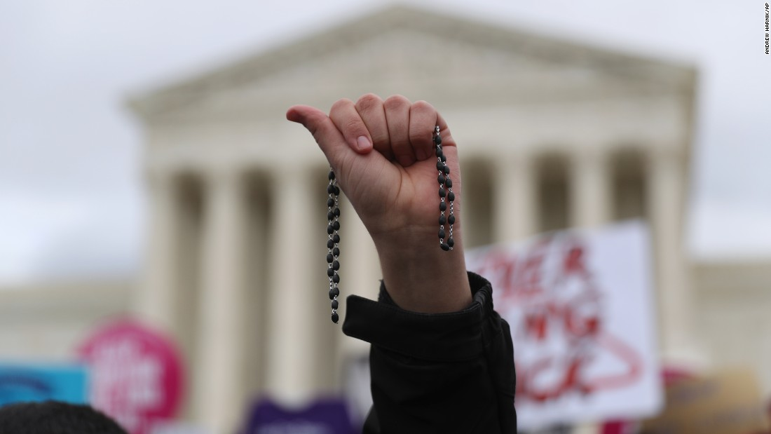 "A participant holds up a rosary outside the Supreme Court. Anti-abortion activists are <a href=""http://www.cnn.com/2016/12/14/politics/trump-abortion-supreme-court/"" target=""_blank"">looking to Trump</a> as he is set to nominate a new Supreme Court justice in the coming weeks."