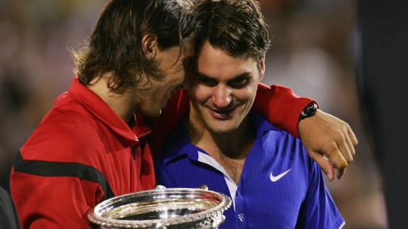Rafael Nadal consoles Roger Federer during the trophy presentation after beating the Swiss in the Australian Open in 2009