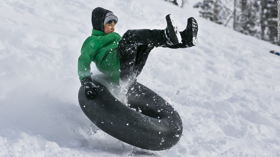Cameron Asay enjoys the snow at a park in McKenzie Bridge, Oregon, on Monday, January 2.