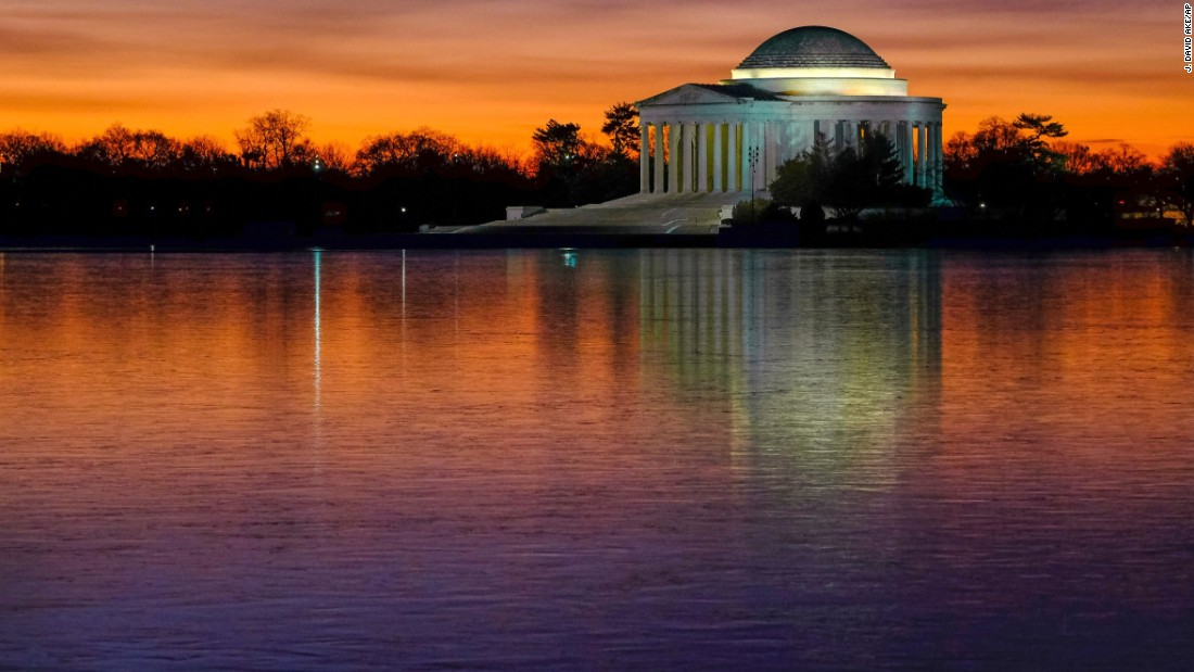 The Jefferson Memorial is reflected off the Tidal Basin on a cold morning in Washington on Monday, January 9.<br />