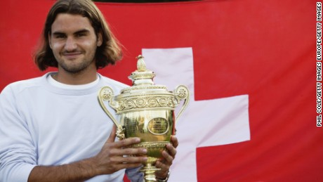 Federer poses with his first Wimbledon trophy in 2003.