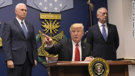 US President Donald Trump speaks after signing executive orders alongside US Defense Secretary James Mattis (R) and US Vice President Muike Pence on January 27, 2016 at the Pentagon in Washington, DC.