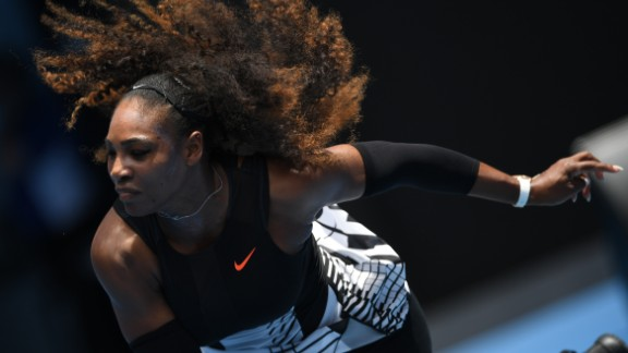 Serena Williams of the US serves against Switzerland's Belinda Bencic during their women's singles match on day two of the Australian Open tennis tournament in Melbourne on January 17, 2017. / AFP / GREG WOOD / IMAGE RESTRICTED TO EDITORIAL USE - STRICTLY NO COMMERCIAL USE        (Photo credit should read GREG WOOD/AFP/Getty Images)