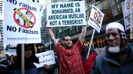A group of Muslims take part in a rally in front of Trump Tower December 20, 2015 in New York. Republican presidential hopeful Donald Trump proposed a call for a ban on Muslims entering the United States.