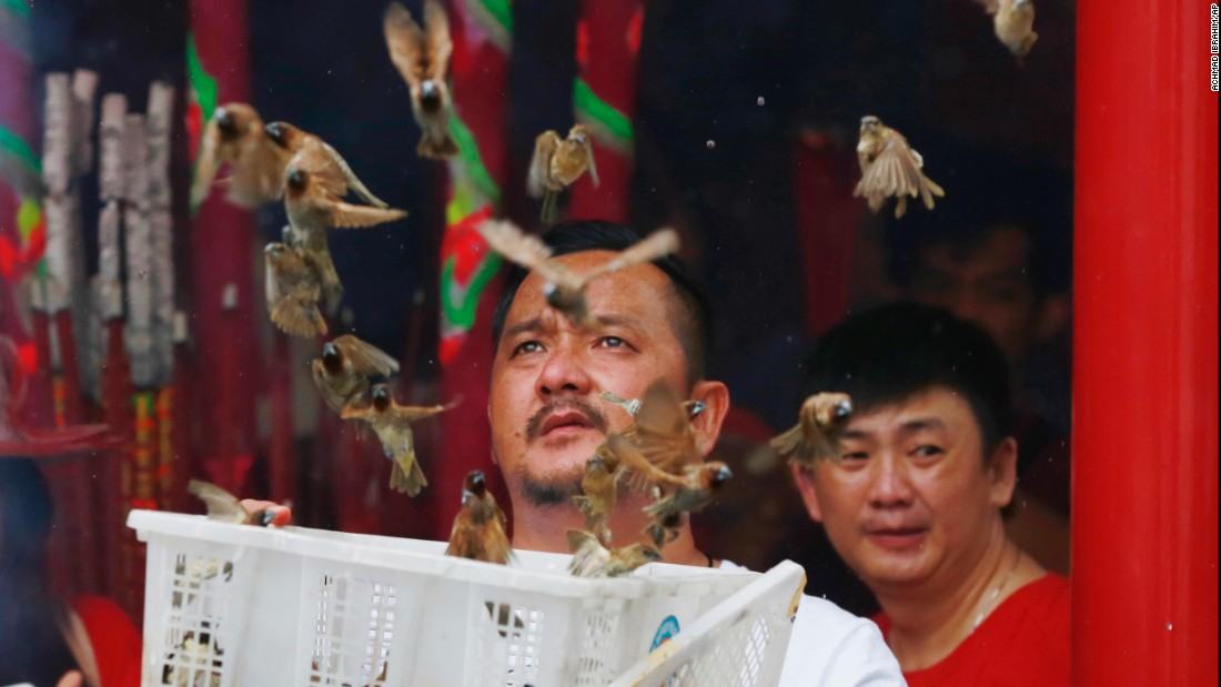 A man releases birds to bring good luck at the Dharma Bakti Temple in Jakarta, Indonesia.