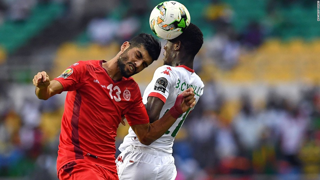 Tunisia's Ferjani Sassi (L) and Cyrille Bayala of Burkina Faso tussle in the air in what was a tense quarterfinal.
