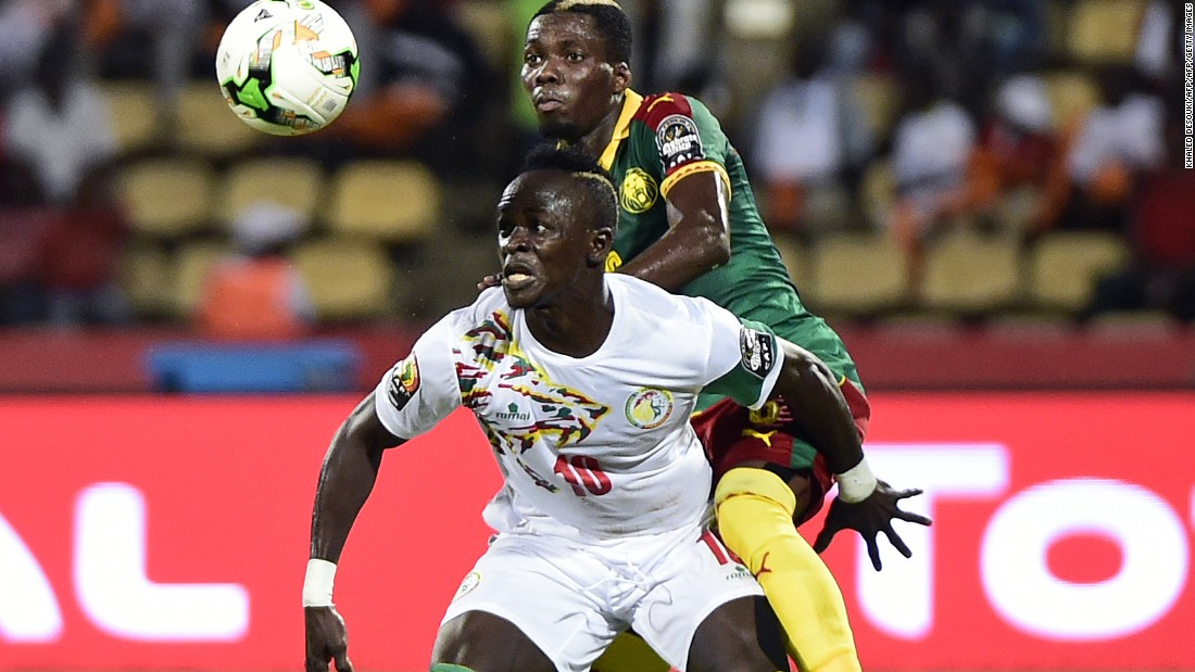 Cameroon defender Ambroise Oyongo challenges Senegal's Sadio Mane -- the Liverpool winger who would later miss a crucial penalty.