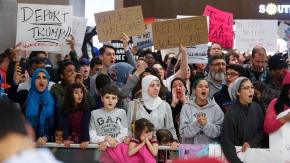DALLAS, TX - JANUARY 28: Protesters gather to denounce President Donald Trump's executive order that bans certain immigration, at Dallas-Fort Worth International Airport on January 28, 2017 in Dallas, Texas. President Trump signed the controversial executive order that halted refugees and residents from predominantly Muslim countries from entering the United States. (Photo by G. Morty Ortega/Getty Images)