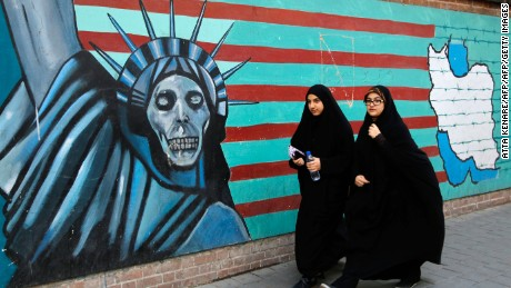 Iranian women walk past the former US embassy in Tehran in November 2016 during a demonstration marking the anniversary of the 1979 hostage crisis.