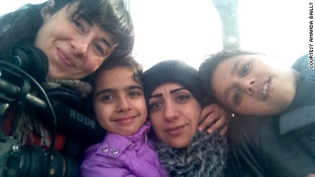 "Filmmaker Amanda Bailly with the Syrian family chronicled in her film ""8 Borders, 8 Days."""