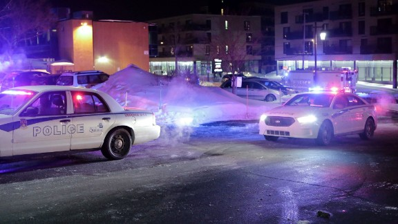 """Police survey the scene after deadly shooting at a mosque in Quebec City, Canada, Sunday, Jan. 29, 2017. Quebec Premier Philippe Couillard termed the act """"barbaric violence"""" and expressed solidarity with victims"""