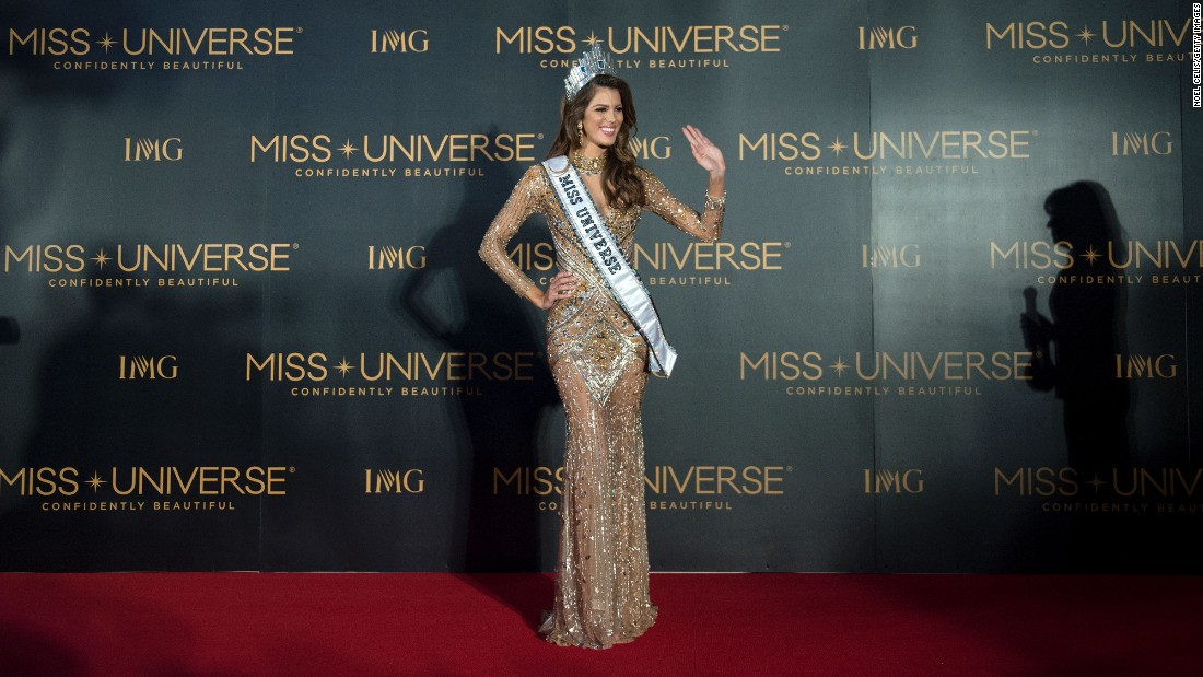The new Miss Universe Iris Mittenaere of France waves to photographers during a press conference after being crowned the winner.