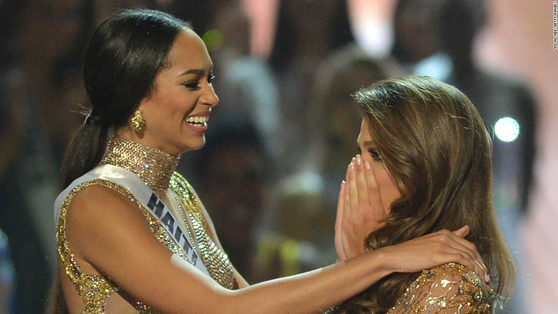 Four days later, at the final judging, Miss Universe candidate Iris Mittenaere (R) of France reacts after being named Miss Universe over fellow candidate, first runner-up Raquel Pellisier of Haiti (L).