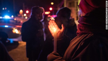 People come to show their support after a shooting occurred in a mosque at the Québec City Islamic cultural center on Sainte-Foy Street in Quebec city on January 29, 2017.