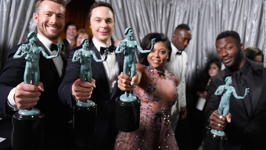 "Glenn Powell, Jim Parsons, Taraji P. Henson, and Aldis Hodge, co-recipients of the outstanding cast in a motion picture award for ""Hidden Figures."""