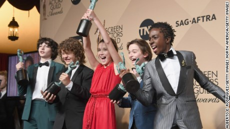 Actors Finn Wolfhard, Gaten Matarazzo, Millie Bobby Brown, Noah Schnapp, and Caleb McLaughlin co-recipients of the Outstanding Performance by an Ensemble in a Drama Series award for 'Stranger Things,' pose in the press room during the 23rd Annual Screen Actors Guild Awards at The Shrine Expo Hall on January 29, 2017 in Los Angeles.  (Photo by Alberto E. Rodriguez/Getty Images)