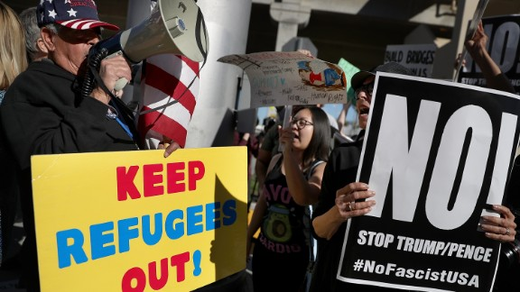 A protester faces off with a supporter of U.S. President Donald Trump during a demonstration against the immigration ban that was imposed by  President Trump at Los Angeles International Airport on January 29, 2017 in Los Angeles, California. Thousands of protesters gathered outside of the Tom Bradley International Terminal at Los Angeles International Airport to denounce the travel ban imposed by President Trump. Protests are taking place at airports across the country.