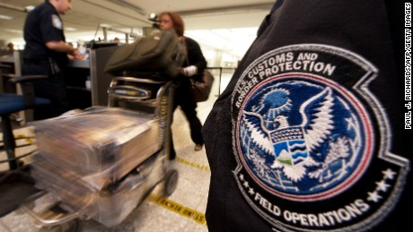 An air traveler is cleared by a Customs and Border Protection Officer at Dulles International Airport outside Washington.