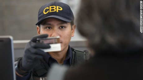 SAN YSIDRO, CA - SEPTEMBER 23:  A U.S. Customs and Border Protection officer checks identifications as people cross into the United States from Mexico on September 23, 2016 in San Ysidro, California. More than 10,000 people legally cross the border, mostly for work, at San Ysidro daily, making it the busiest port of entry on the 2,000 mile border between the United States and Mexico. Securing the border and controlling illegal immigration have become key issues in the U.S. Presidential campaign.  (Photo by John Moore/Getty Images)