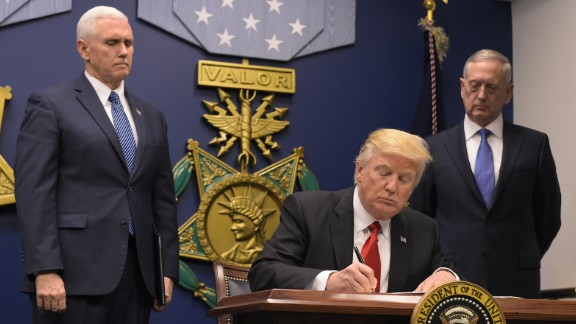 US President Donald Trump signs an executive order alongside US Defense Secretary James Mattis and US Vice President Muike Pence on January 27, 2017, at the Pentagon in Washington, DC.