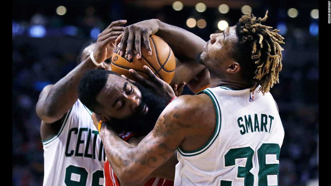 Houston guard James Harden, center, tries to hang onto the ball as he's guarded by Boston's Jae Crowder and Marcus Smart on Wednesday, January 25.