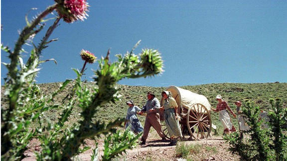 Mormons pass into Utah, re-enacting the trek the first Mormons took west 150 years ago. (MIKE NELSON/AFP/Getty Images)